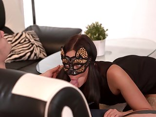 Babe in gown mask Leanne Lace gives a sensual blowjob and gets nailed