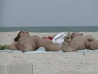 Very horny milf scraping boobs in nude beach