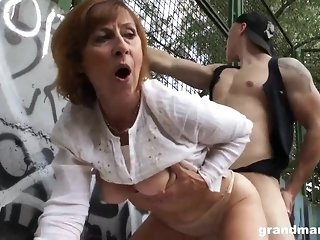 Mature gal is deep-throating manstick in a public office and getting porked stiff, in return sex video