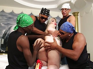 Big bottomed and stance tittied blond trannie Lexie Beth takes part in interracial gangbang