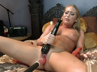 Collared blonde is machine fucked