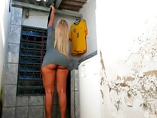 Sexy Brazilian blonde dressed in above moreover rude gray mini threads